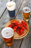 Tasty boiled crayfishes and beer on  table Royalty Free Stock Photo