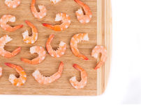 Tasty boiled shrimps on cutting board. Royalty Free Stock Photography