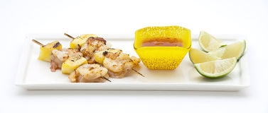 Tasty boiled shrimps. With skewers on a stone plate with lime and salad Royalty Free Stock Images