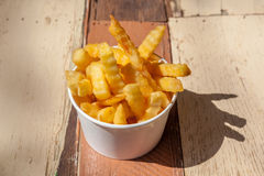 Tasty bowl of homemade French fries on wooden table background. Royalty Free Stock Image