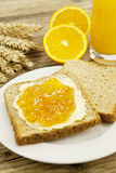 Tasty breackfast with toast and marmelade on table Stock Photo