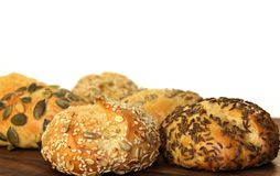 Tasty bread rolls. Various types of bread rolls on a wooden board Royalty Free Stock Images
