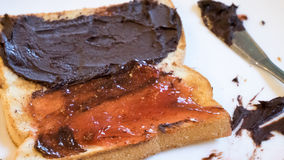 Tasty bread toast and strawberry jam with chocolate spread Royalty Free Stock Images