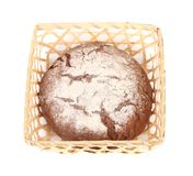 Tasty bread in wicker basket. Stock Photos