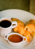 Tasty breakfast:coffee with croissants and jam on wooden backgro Royalty Free Stock Photos