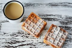 Tasty breakfast, delicious fresh Viennese waffles and cup of coffee on wooden background stock images