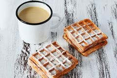 Tasty breakfast, delicious fresh Viennese waffles and cup of coffee on wooden background stock photography