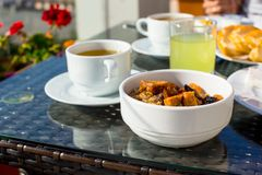 Tasty breakfast with flakes,dried fruit and cup of Royalty Free Stock Images