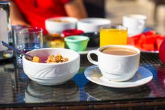 Tasty breakfast with flakes,dried fruit and cup of Royalty Free Stock Photo