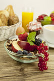 Tasty breakfast with flakes and fruits in morning Royalty Free Stock Photo