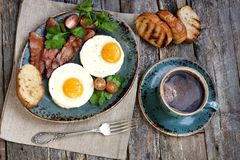 Tasty breakfast with fried eggs Stock Photos