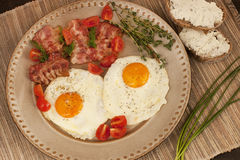 Tasty breakfast with fried eggs Royalty Free Stock Image