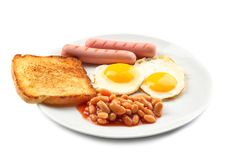 Tasty breakfast with fried eggs. On white background royalty free stock photography