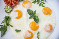Tasty breakfast- fried eggs with vegetables Royalty Free Stock Image