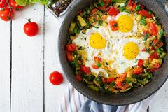 Tasty breakfast. Fried eggs with vegetables. Shakshuka. Top view. Flat lay royalty free stock image