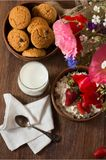 Tasty breakfast of homemade cottage cheese with strawberry, glass of milk and cookies royalty free stock images