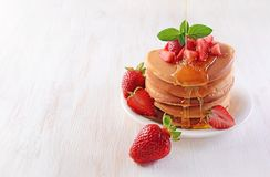 Tasty breakfast. Homemade pancakes with fresh strawberry, honey and mint Stock Photography