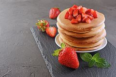 Tasty breakfast. Homemade pancakes with fresh strawberry and mint Royalty Free Stock Images