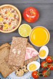 Tasty breakfast with juice, muesli, apple and bread Royalty Free Stock Photos
