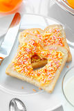 Tasty breakfast made of bread and candies Stock Photography