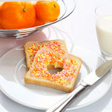 Tasty breakfast made of bread with candies Stock Image