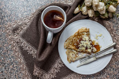 Tasty breakfast with pancake and herbal tea Stock Images