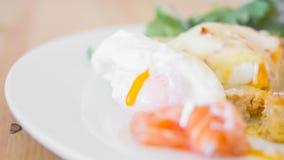 Tasty breakfast - Poached eggs. Tasty and delicious breakfast - Poached eggs with fresh salt salmon Stock Photos