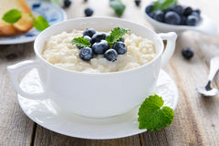 Tasty breakfast: rice pudding with blueberry Stock Image