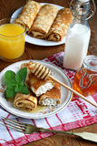 Tasty breakfast. Rolled pancakes with cottage cheese close up Stock Photos