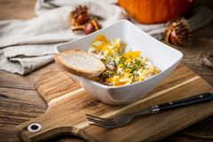 Scrambled eggs with sausage and bread. Tasty breakfast - scrambled eggs with sausage and bread Stock Photos