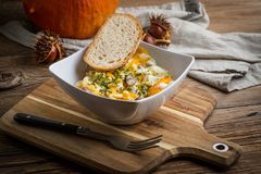Scrambled eggs with sausage and bread. Tasty breakfast - scrambled eggs with sausage and bread Royalty Free Stock Photography