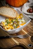 Scrambled eggs with sausage and bread. Tasty breakfast - scrambled eggs with sausage and bread Stock Image