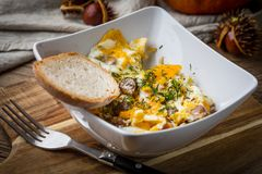 Scrambled eggs with sausage and bread. Tasty breakfast - scrambled eggs with sausage and bread Stock Photo