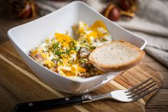 Scrambled eggs with sausage and bread. Tasty breakfast - scrambled eggs with sausage and bread Stock Images