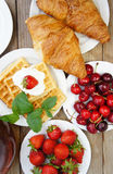 Tasty breakfast - tea, croissants, wafers and fruits Royalty Free Stock Photography