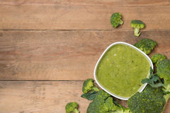 Tasty broccoli soup on a wooden background Stock Image