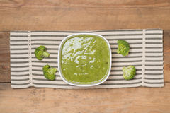 Tasty broccoli soup on a wooden background Stock Images
