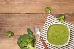 Tasty broccoli soup on a wooden background Royalty Free Stock Images