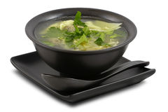 Tasty broth on white, isolated. Tasty broth served in stylish; black bowl; on white; isolated Stock Photos