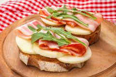 Tasty bruschetta with bacon Stock Photos