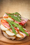 Tasty bruschetta with bacon Royalty Free Stock Images