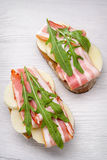 Tasty bruschetta with bacon Royalty Free Stock Photos