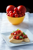 Tasty bruschetta on the plate Stock Photography