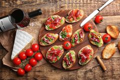 Tasty bruschetta served with wine Royalty Free Stock Photos