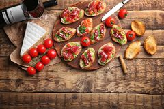 Tasty bruschetta served with wine Stock Images