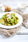 Tasty Brussels sprouts with sauce Royalty Free Stock Images