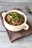 Tasty Buckwheat with mushrooms in a bowl Stock Photos