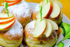 Tasty buns with some pieces of an apple Royalty Free Stock Images