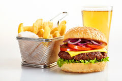 Tasty burger with basket of fries and beer royalty free stock image