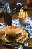 Tasty burger with beef and french fries and soda Royalty Free Stock Photography